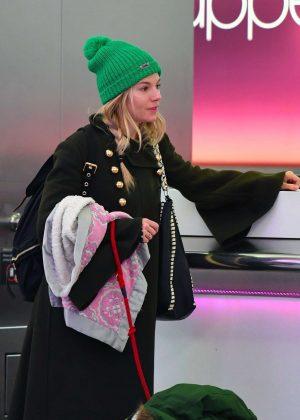 Sienna Miller at Heathrow Airport in London