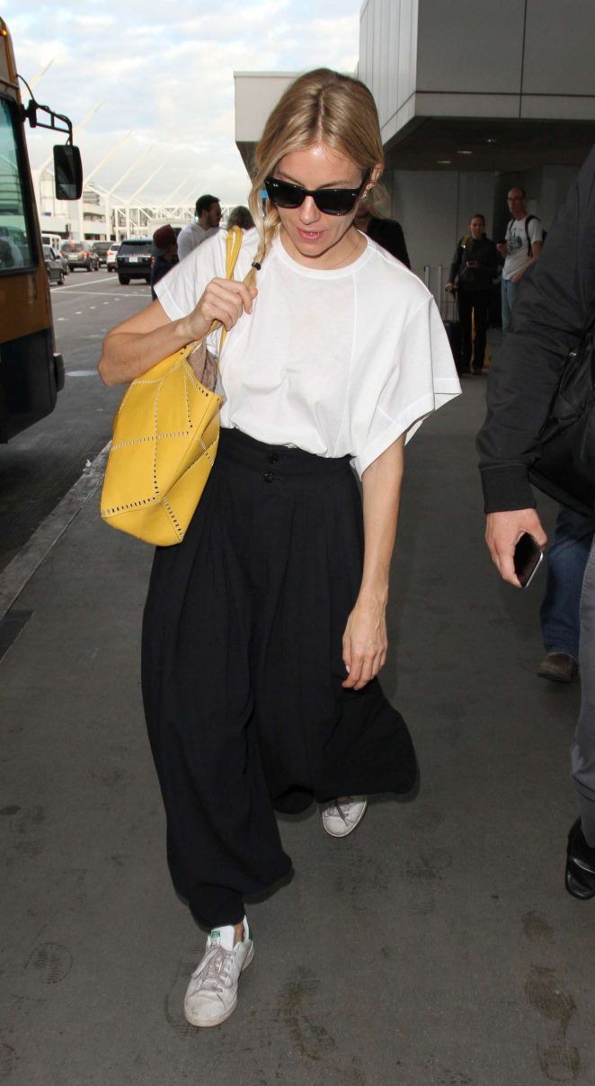 Sienna Miller at LAX airport in Los Angeles -02