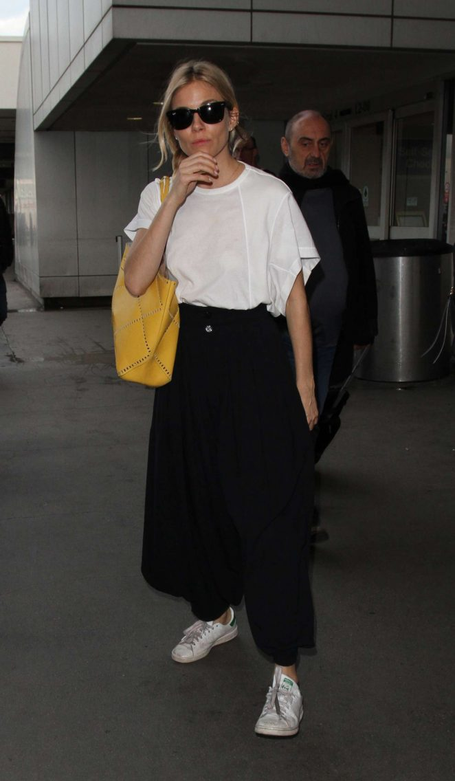 Sienna Miller at LAX airport in Los Angeles -13