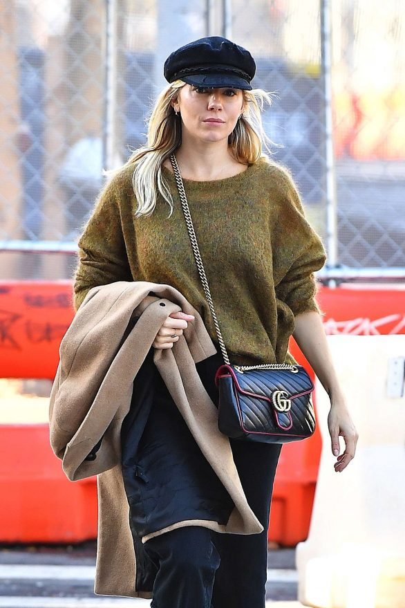 Sienna Miller in a green sweater in New York City