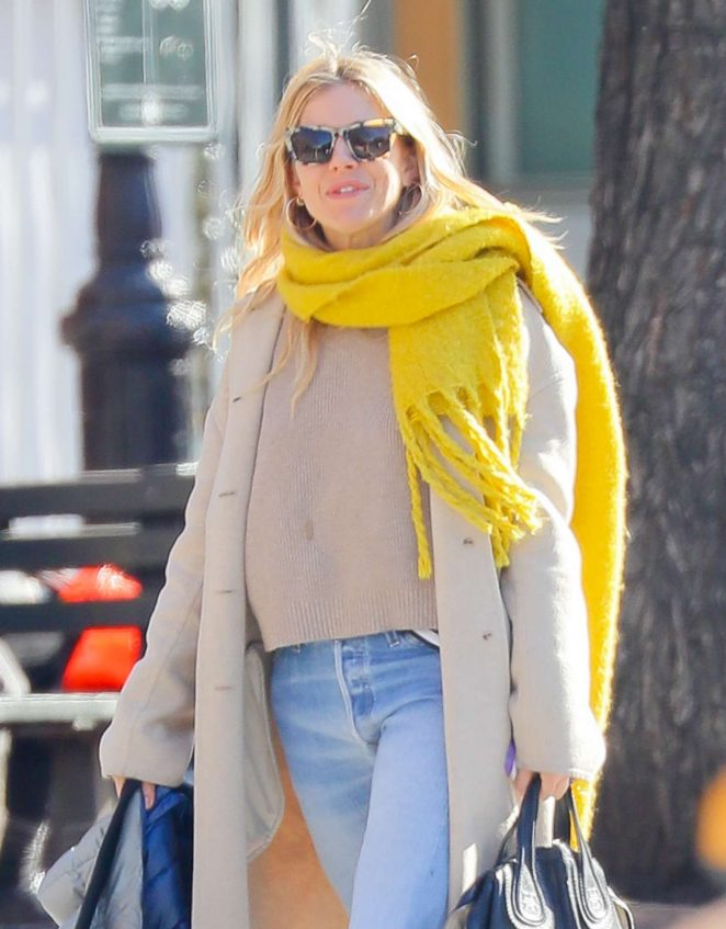 Sienna Miller in a yellow scarf out in New York City