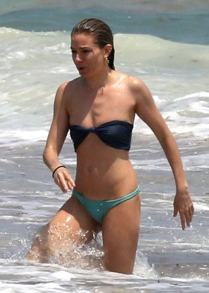 Sienna Miller in Bikini on the beach in Cancun