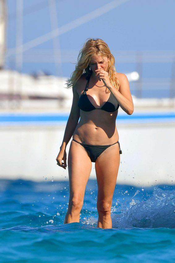 Sienna Miller in Black Bikini on a boat in St. Tropez