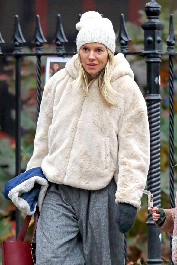 Sienna Miller - Wears a hooded fur coat out in NYC