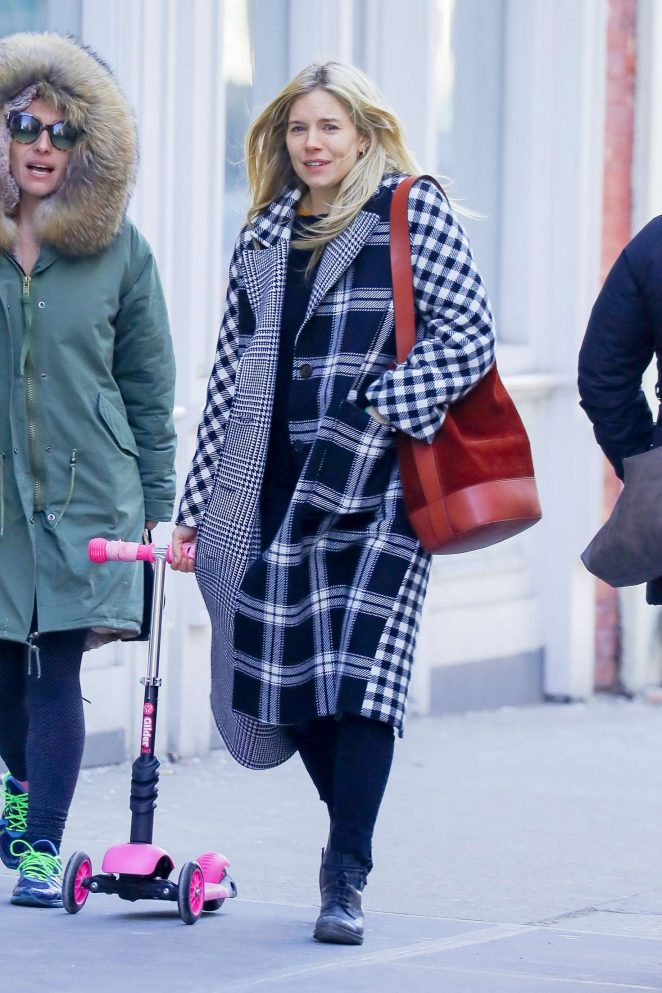 Sienna Miller wears a plaid coat out in New York City