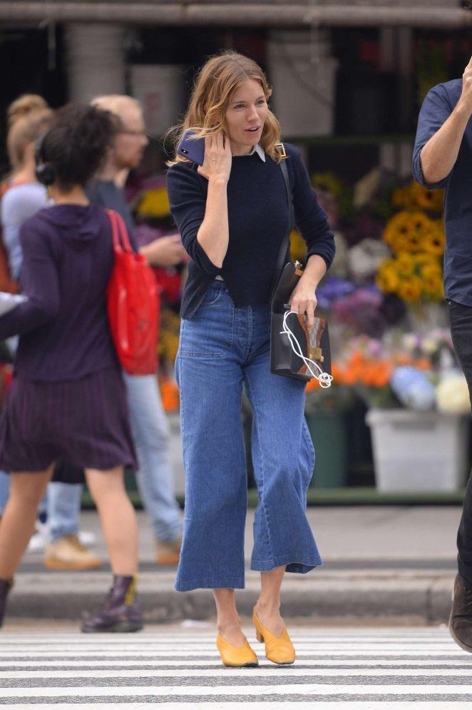 Sienna Miller - Wears vintage flare denim pants in New YorK City