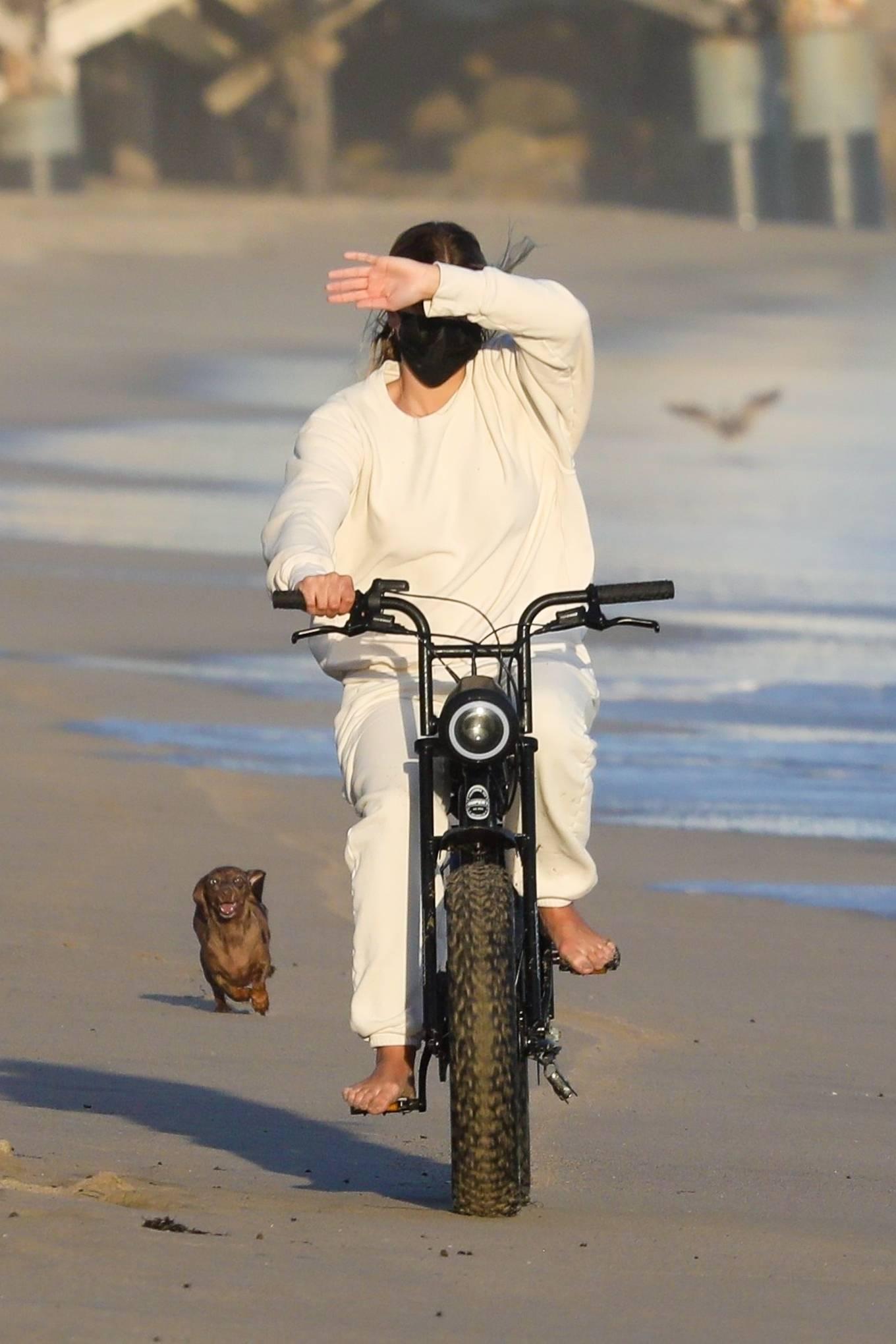 Sofia Richie - Riding motorbike on the beach in Malibu