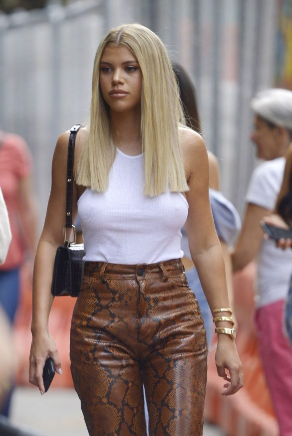Sofia Richie - Wearing a white tank top and snake leather pants in New York City