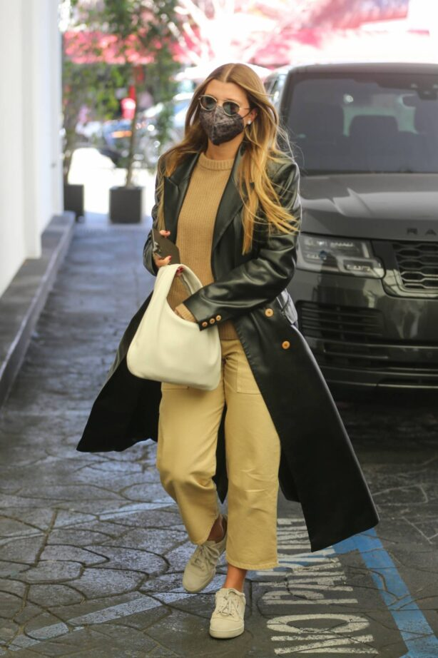 Sofia Richie - Wears a black trench coat at skincare clinic in Beverly Hills