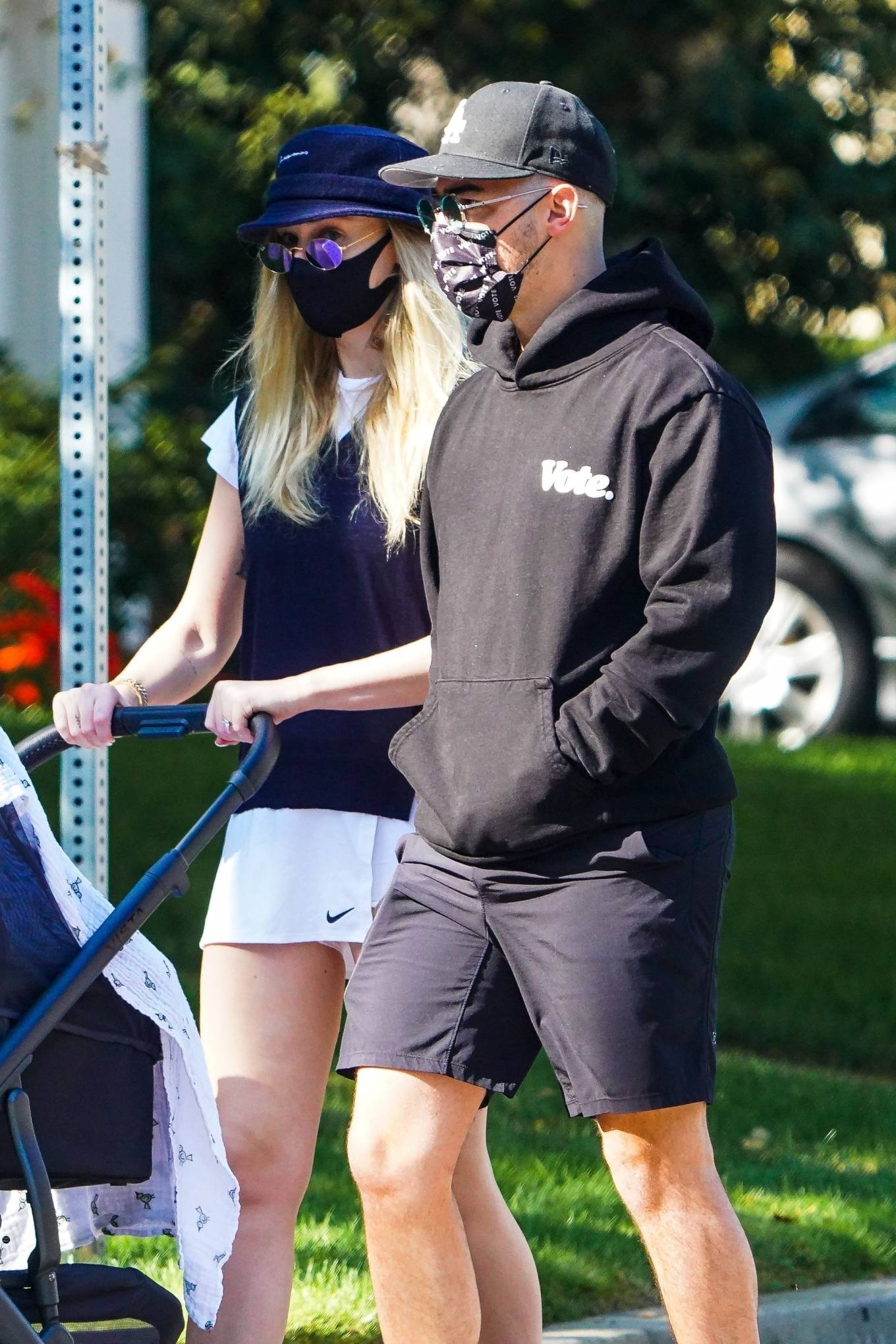 Sophie Turner and Joe Jonas - Out for a walk with their new baby Willa in Los Angeles