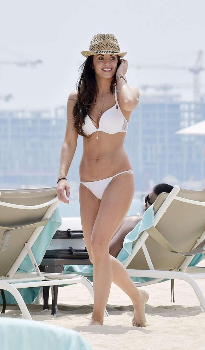 Stacey Flounders in White Bikini on the beach in Dubai