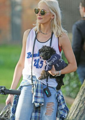 Stephanie Pratt with her dog out in London