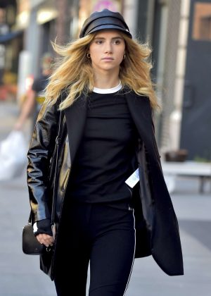 Suki Waterhouse in Black out in New York