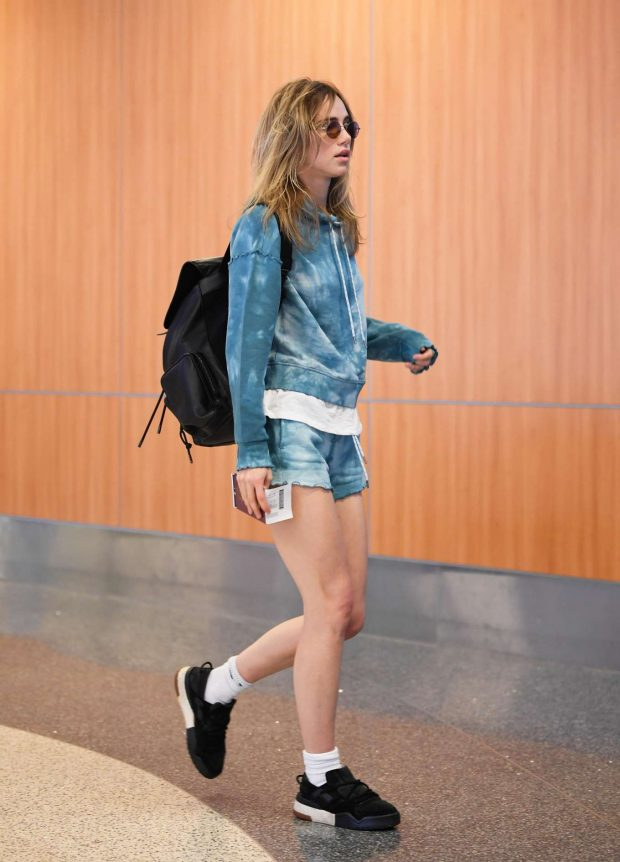 Suki Waterhouse in Denim Shorts - Arrives at LAX Airport in Los Angeles