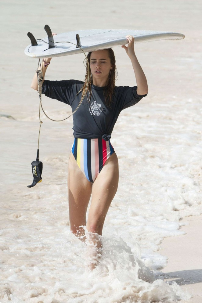 Suki Waterhouse in Swimsuit Surfing in Barbados