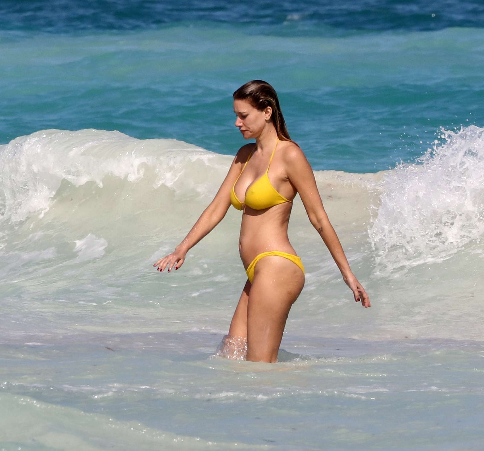 Susan Holms in Yellow Bikini on the beach in Tulum