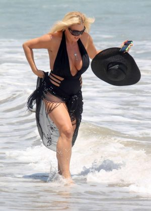 Suzie Malone in Black Swimsuit on Malibu Beach