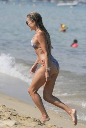 Sylvie Meis - In a bikini with her husband Niclas Castello on the beach La Réserve in Ramatuelle