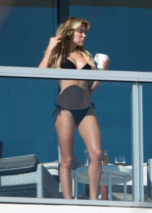 Sylvie Meis in Black Bikini on balcony in Miami