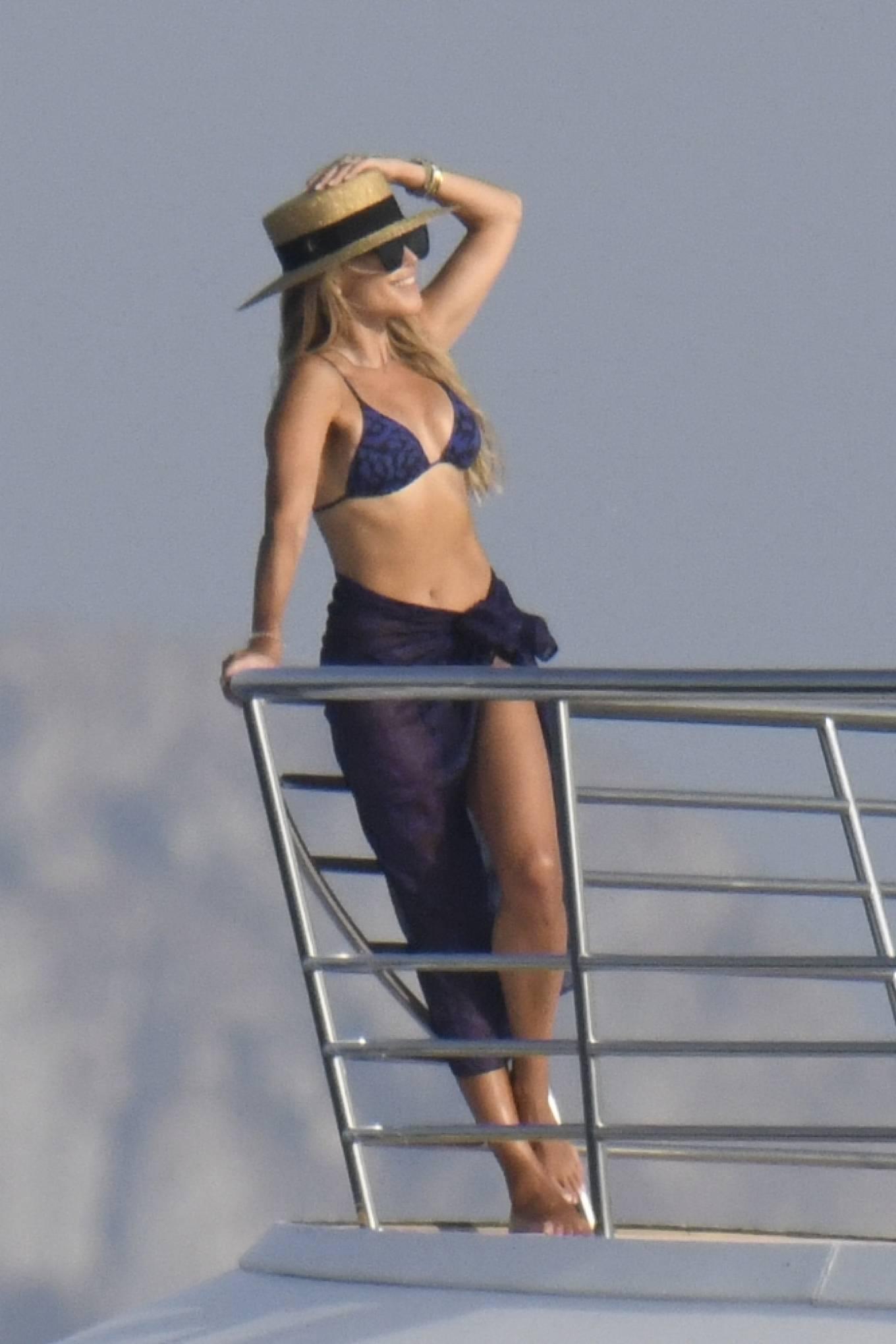 Sylvie Meis - In black bikini with Niclas Castello on a yacht in Porto Cervo