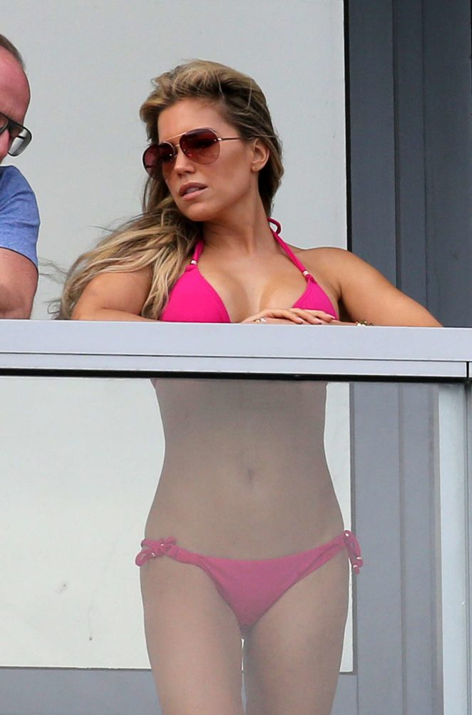 Sylvie Meis in Pink Bikini on balcony in Miami