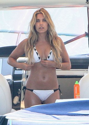 Sylvie Van Der Vaart in White Bikini on a boat in Formentera