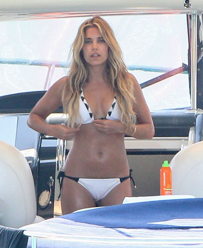 Sylvie Van Der Vaart in White Bikini on a boat in Formentera