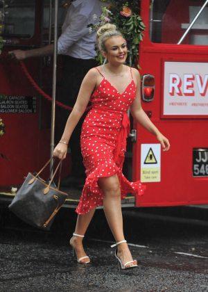 Tallia Storm in Red Dress at Jikoni Restaurant in London