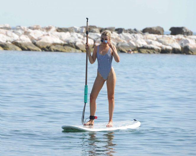 Tallia Storm in Swimsuit Paddle boarding in Marbella