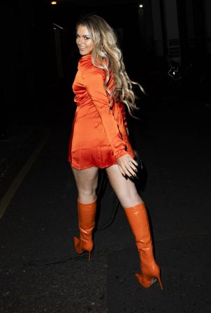 Tallia Storm - Night out in orange dress and high knee boots in London