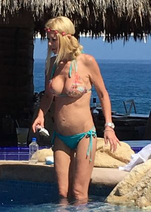 Tara Reid in Bikini at a pool in Mexico
