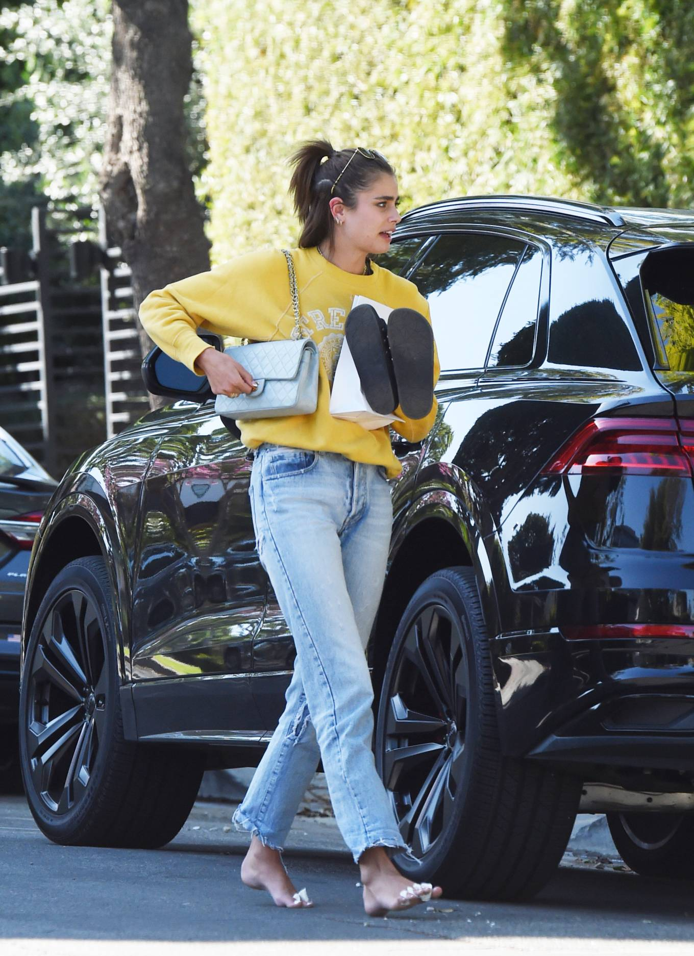 Taylor Hill - Is seen arriving at her house barefoot in Los Angeles