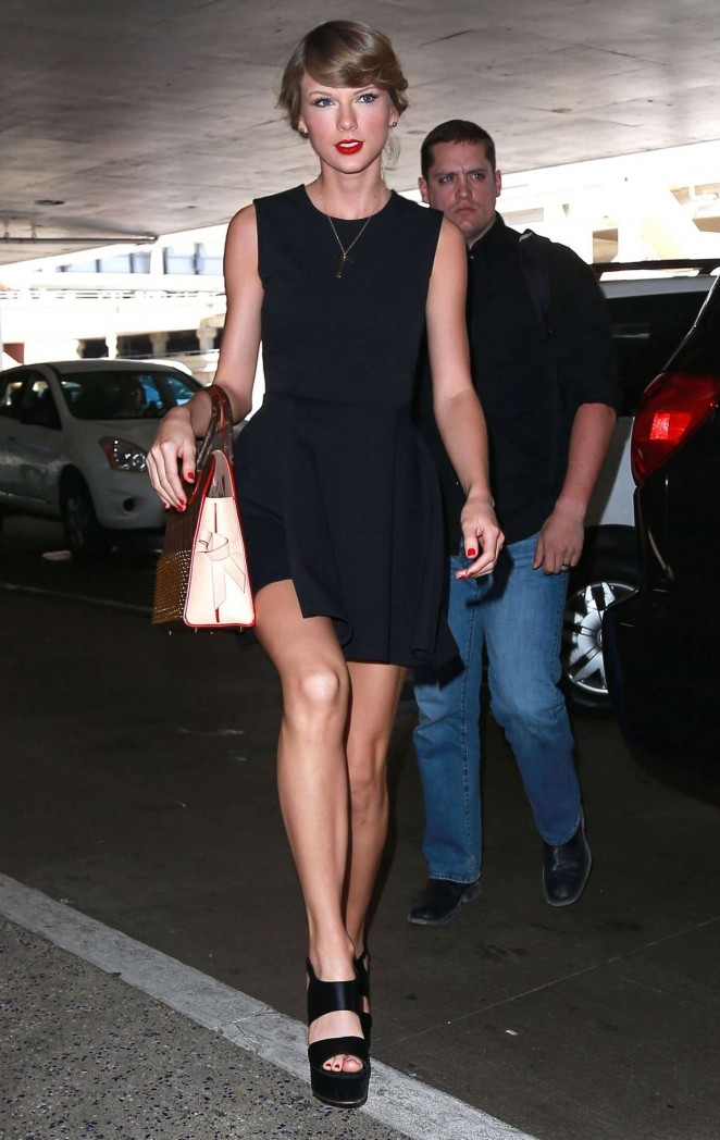 Taylor Swift in Black Mini Dress at LAX Airport in LA