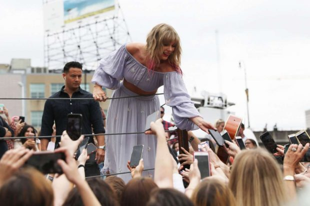 Taylor Swift at the new Kelsey Montague What Lifts You Up Mural -02