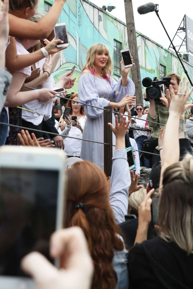 Taylor Swift at the new Kelsey Montague What Lifts You Up Mural -05