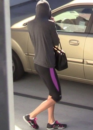Taylor Swift hides her face with a hoodie while leaving the gym in LA