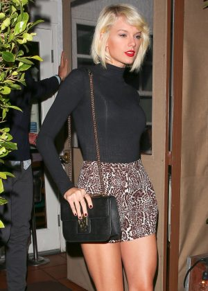 Taylor Swift in leopard print hotpants at Giorgio Baldi in LA
