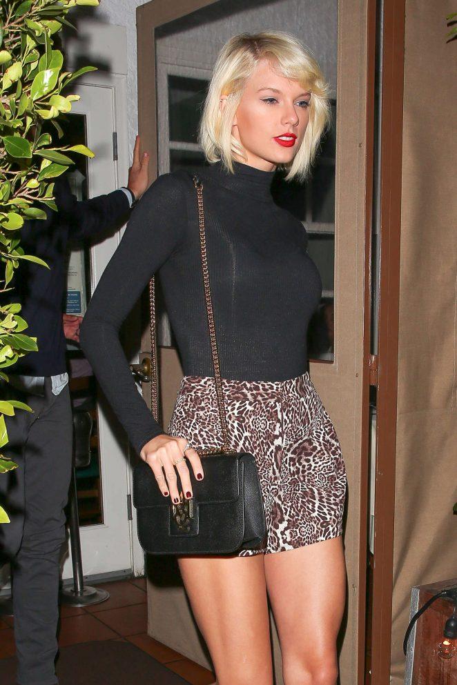Taylor Swift in leopard print hotpants at Giorgio Baldi in LA