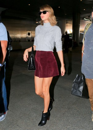 Taylor Swift in Short Red Skirt at LAX Airport in LA