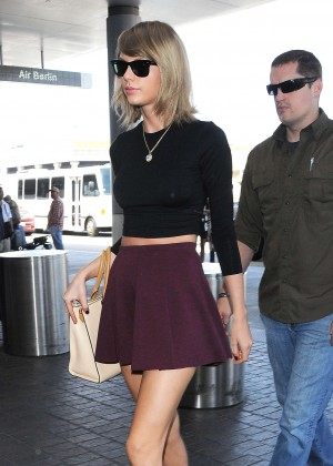 Taylor Swift in Short Skirt at LAX airport in LA