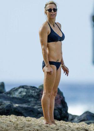 Tea Leoni in Black Bikini on the beach in Barbados