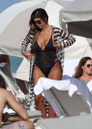 Teresa Giudice in Black Swimsuit on the beach in Miami