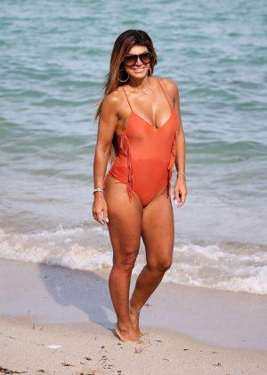 Teresa Giudice in Peach Swimsuit on the beach in Miami
