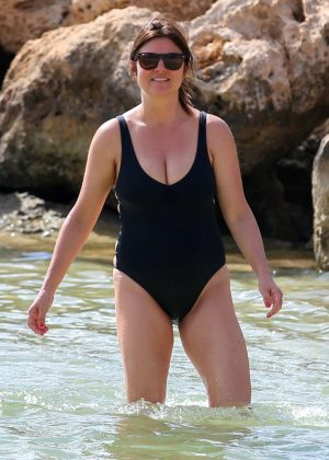 Tiffani Amber Thiessen in Black Swimsuit on the beach in Oahu