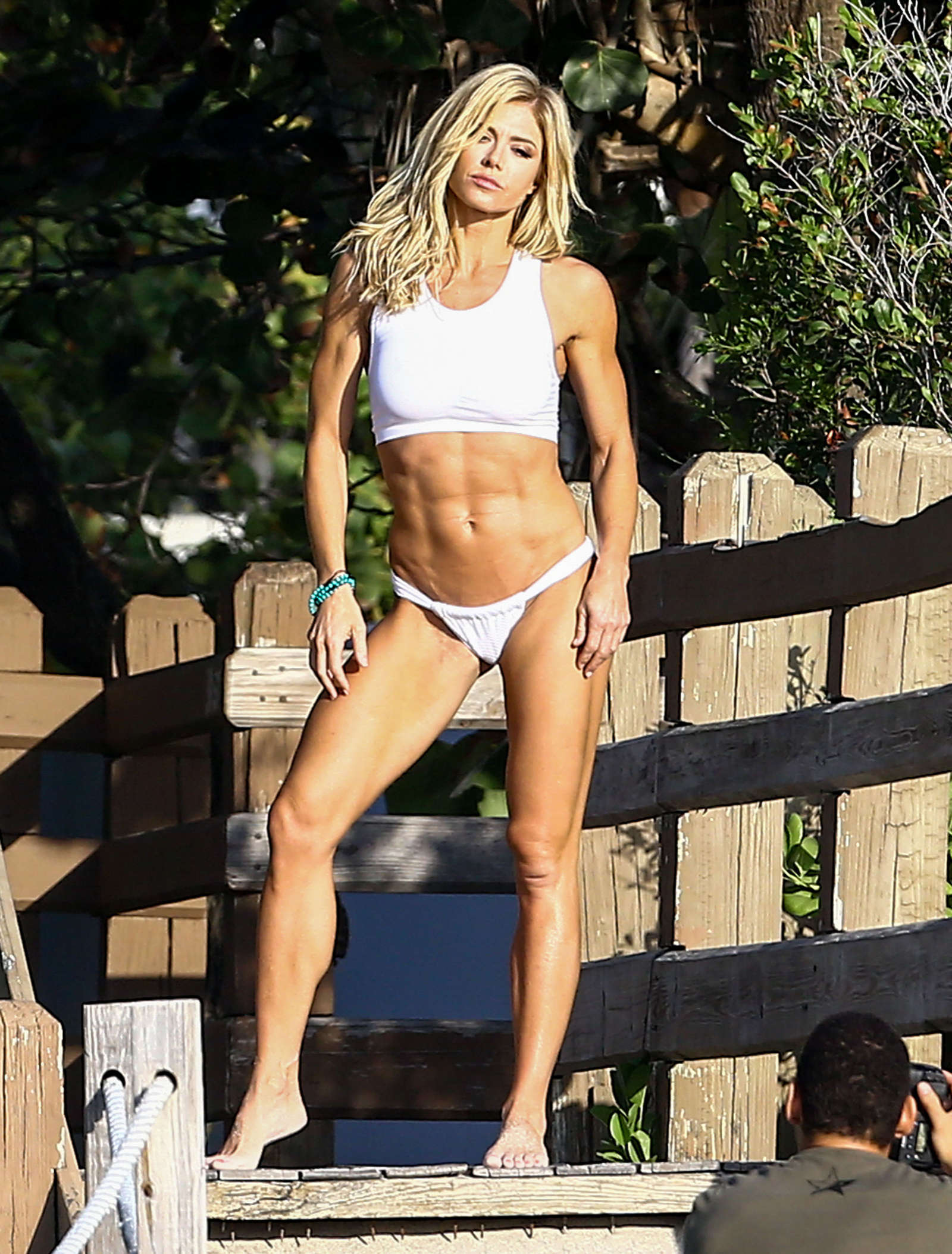 Torrie Wilson in Bikini on a photoshoot at the beach
