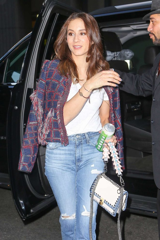 Troian Bellisario in jeans returns to her hotel in NYC