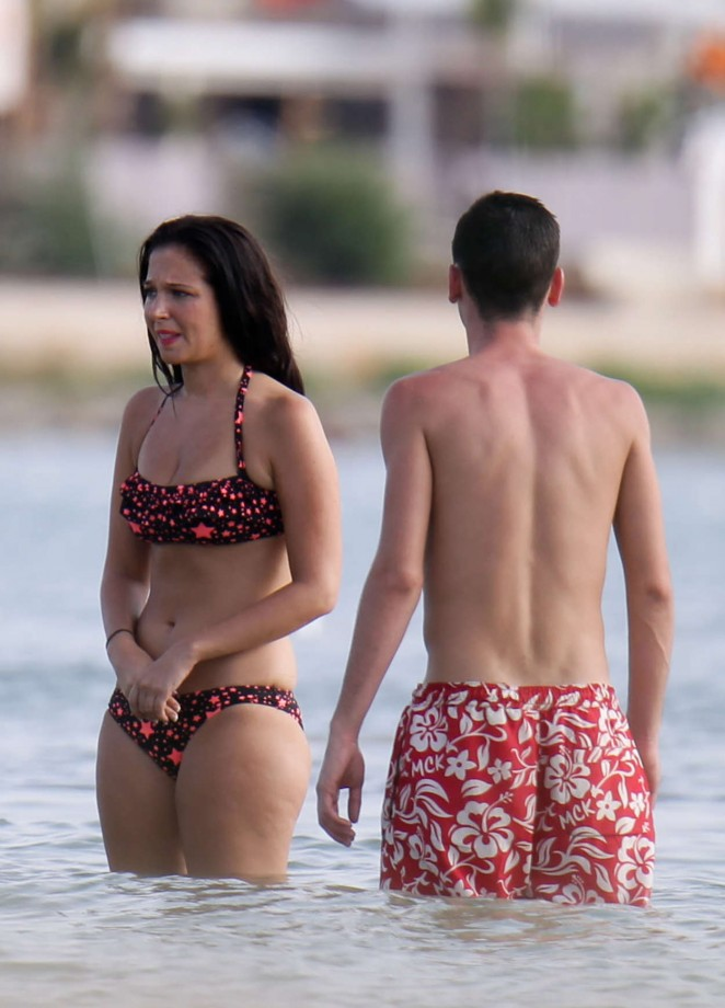 Tulisa Contostavlos in Bikini on a beach in Ibizia