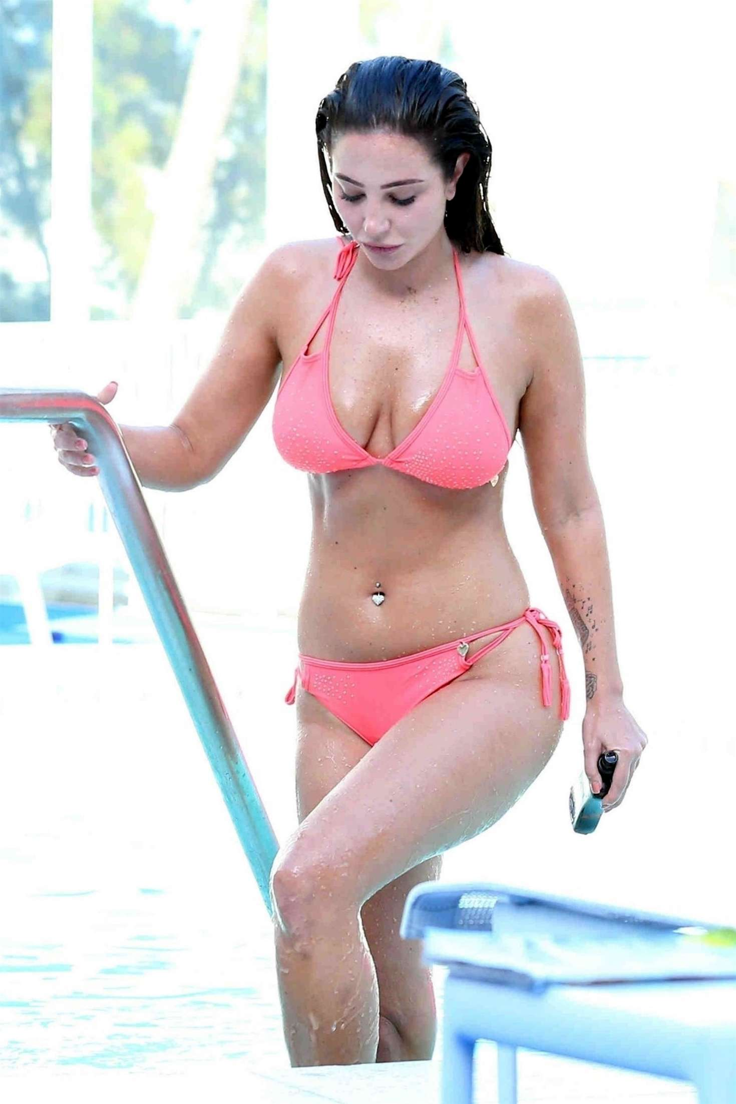 Tulisa Contostavlos in Pink Bikini on the pool in Los Angeles