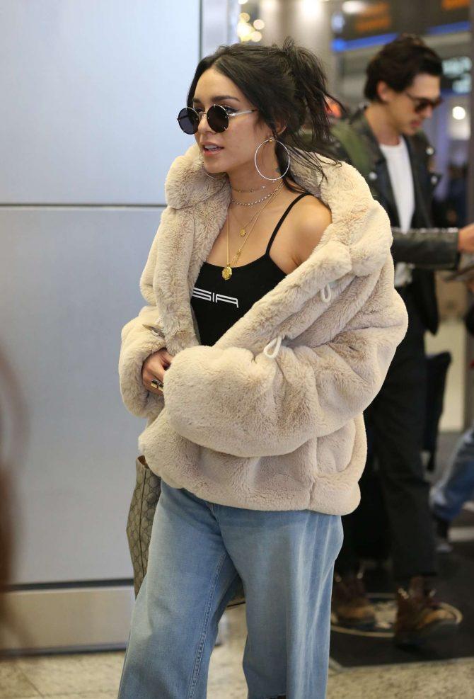 Vanessa Hudgens - Arriving at Miami International Airport