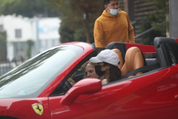 Vanessa Hudgens - Drives her red Ferrari with GG Magree in West Hollywood